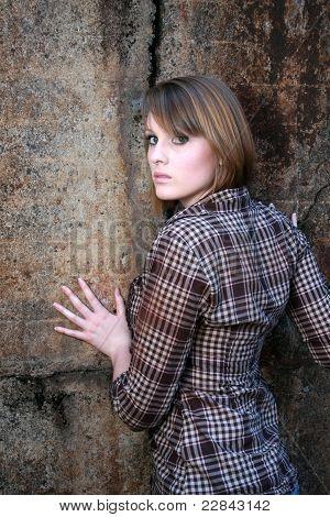 Beautiful Woman Leaning On Wall
