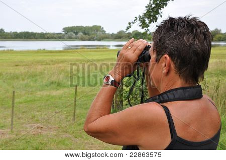Senior Woman Watching Birds