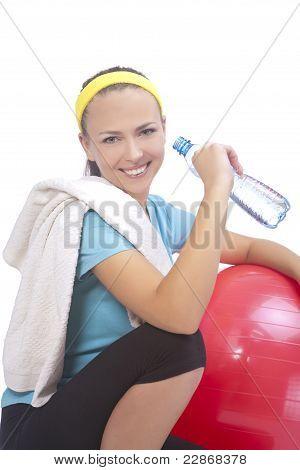 Portrait Of Sportswoman Drinking Water After Training With Fitball