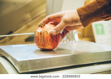 Man Weigh Garnet On Digital