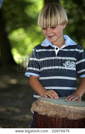 Boy playing African drum