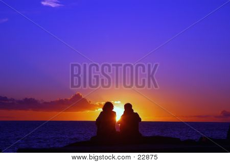 Couple Appreciating The Sunset