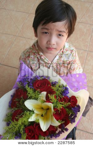 Boy Holding Bouquet