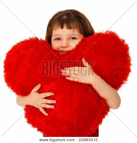 Little Girl Hugging A Large Toy Heart