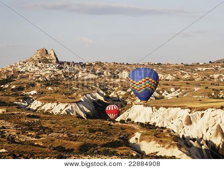 Blue And Red Hot Air Balloons Navigate Gorge, Uchisar