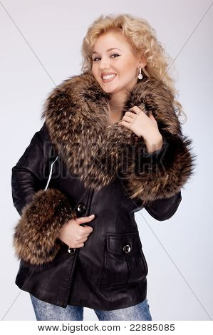 Beautiful Smiling Woman In A Winter Jacket With A Fur Collar