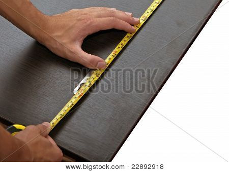 Mans Hand Using Tape Measure