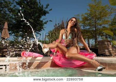 Young Brunette Woman At The Pool Swimming And Enjoying Herself