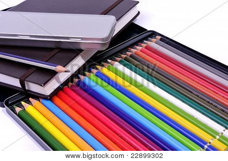 Illustrator book , black pencil and colored pencils case