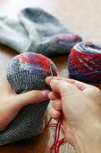 darning socks, repairing holes in socks poster