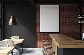 Brick And Black Loft Bar Interior With A Concrete Floor, A Bar With Stools And Wooden Tables With Ch poster