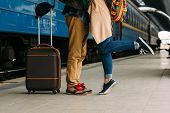 Closeup Shot Of Woman Feet Standing On Tiptoe While Embracing Her Man At Railway Platform For A Fare poster