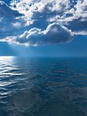Background Of Stormy Sky With Sunrays Between Clouds Reflected In Smooth Wavy Ocean To Illustrate Fl poster