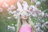 Sensual Woman In Magnolia Bloom. Sensual Sexy Woman In Bunny Ears And Glasses At Magnolia Flower poster