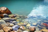 Closeup of rocks in water at lake Louise, Alberta