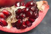 Pomegranate Slice Fruit. Close Up Granate Seeds In Slice. Macro Image. Vitamine And Healthy Concept. poster