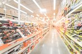 Blurred Wide Aisle Power Tool Combo Kits At Hardware Store In America poster