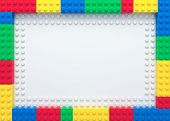 Frame Of Colorful Toy Bricks On White Construction Plate poster