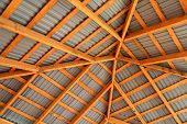 Wooden Frame Of New Roof From Inside. Construction Framework. poster