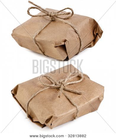 parcel package  wrapped with brown kraft paper tied rope  isolated on white