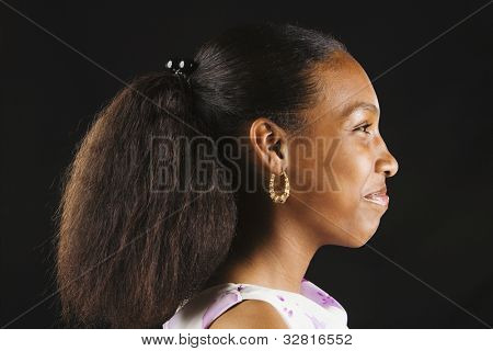 Profile of African woman wearing ponytail
