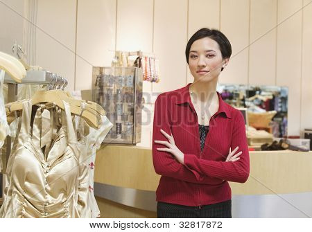 Mixed Race woman working in boutique