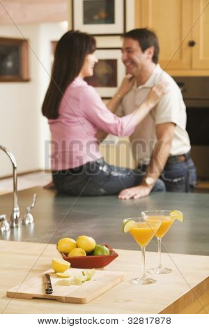 Cocktails in front of multi-ethnic middle-aged couple