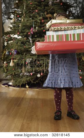 Hispanic girl holding Christmas gift