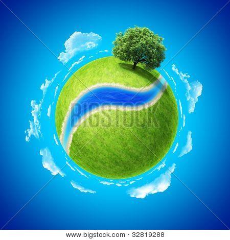 Concepto de mini planeta. Espacio vacío y río en campo verde fresco y árbol denso permanente único. Lugar