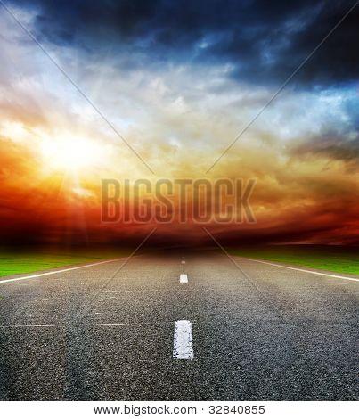 Road In Field Over Stormy Dark Cloudy Sky