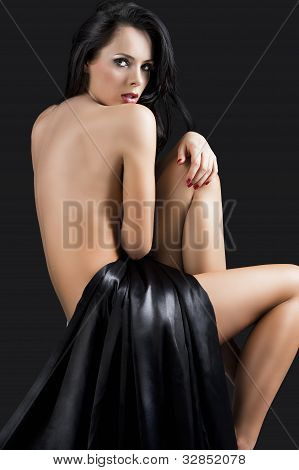 The Nude Cute Sexy Woman Over Black Turned Back