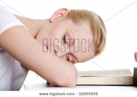 Sleeping while learning - tired teen woman sleeping on desk. Isolated on white background