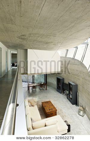 hermosa casa modernista en la vista superior interior de sala de estar de cemento,