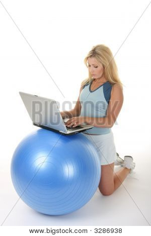 Woman Using Exercise Ball Desk