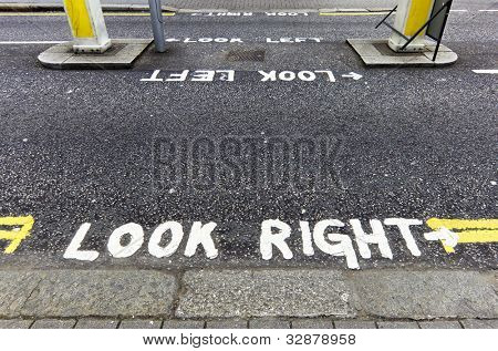 Look right warning painted on the tarmac in London, England, UK