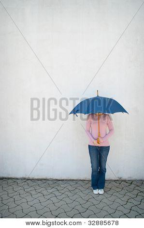 Young Woman Hidden Under Umbrella