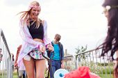 Friends Pulling Trolley As They Arrive At Music Festival Carrying Camping Equipment Onto Site poster