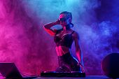 Young Sexy Woman Dj In Bra And Sunglasses Playing Music. Headphones And Dj Mixer On Table. Colorful  poster