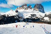 Ski Slopes On Ski Resort In Winter Dolomite Alps. Val Di Fassa, Italy. Skiers Going Down The Slope.  poster