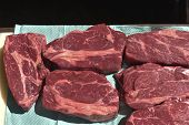 Prime Raw Rib-eye Steak. Raw Beef Steaks.raw Beef Steaks Are Trapped On Paper To Remove Excess Fluid poster