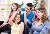 stock photo of contraception  - Teenagers group talking about contraception - JPG