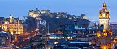 Panorama of Edinburgh Cityscape and castle from Calton Hill at dusk Scotland UK