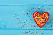 Valentines Day Composition On Blue Background. Heart-shaped Cookie Cutter With Candy Sprinkles, Copy poster