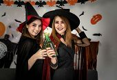 Two young adult and teenager girl celebrating a Halloween party carnival Festival in Halloween costu poster