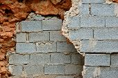 picture of cinder block  - Broken stone and cinder block brick walls background texture - JPG