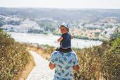 Father Enjoying Walking And Sightseeing With His Kid poster