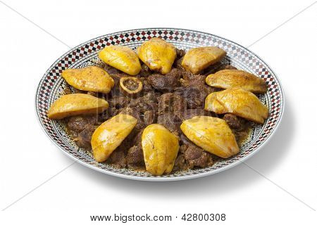 Moroccan dish with meat and Safarjal on white background