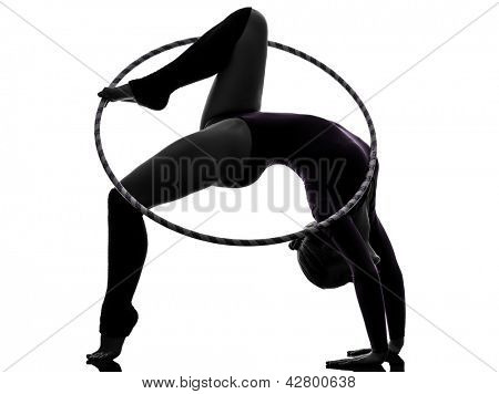 one caucasian woman exercising Rhythmic Gymnastics hula hoop  in silhouette studio isolated on white background