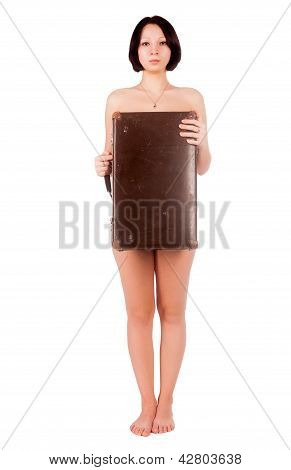 sexy nude woman covering her body by suitcase