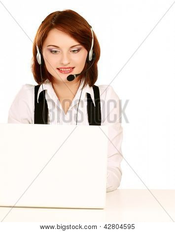 A young woman with a headset working on a laptop
